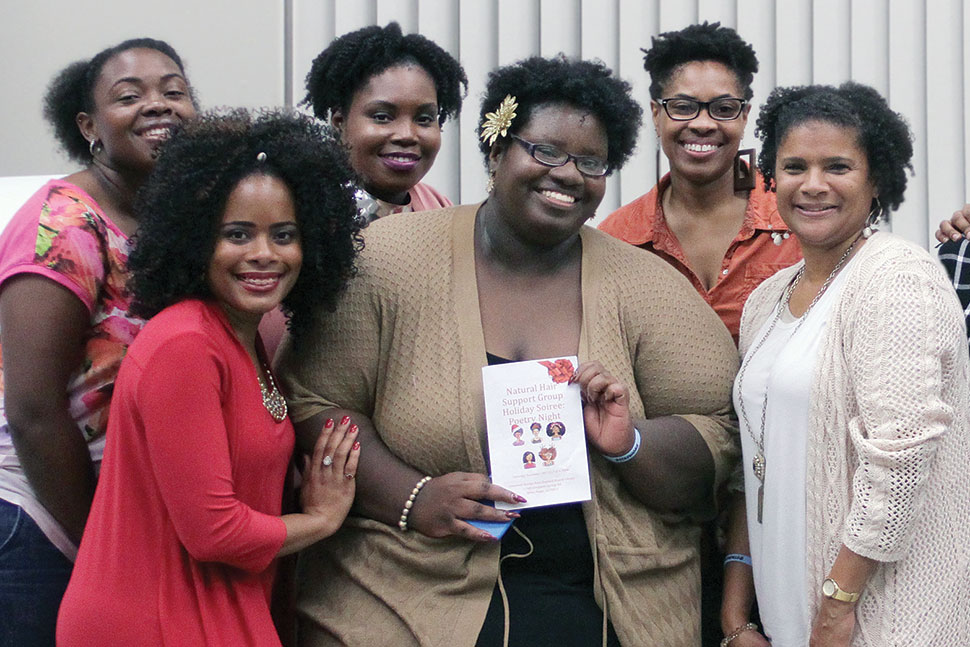 In November 2017, more than 120people attended a poetry event hosted by the Natural Hair Support Group at East Baton Rouge Parish (La.) Library's Greenwell Springs Road Regional branch. The group was founded by Adult Services and Reference Librarian Nicollette M.Davis (holding program book). z