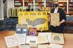 Ellen Keith, director of the Chicago History Museum Library, displays items related to the Great Chicago Fire. Photo: Rebecca Lomax/American Libraries