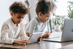 Kids work on a laptop and a tablet (Photo: Marta Wave/Pexels)