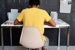 Boy slouching in a hard chair over a table (Photo: Julia M Cameron/Pexels)