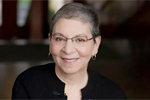 Nancy Pearl (white woman with short graying hair and glasses, wearing a black top)